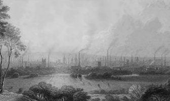 Manchester på midten av 1800-tallet med masse rykende skorsteinspiper i bakgrunnen